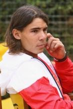Nadal in red and white jacket.jpg