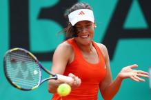 Ana Ivanovic strikes a forehand as her hair flies into her face at the 2010 French Open.JPG