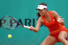 Ana Ivanovic gets down low to hit a forehand at the 2010 French Open.JPG