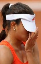 Ana Ivanovic pulls her Adidas visor over her face during the 2010 French Open.JPG