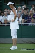 Ana Ivanovic looks dismayed during Wimbledon 2010 with her racket on the ground.JPG