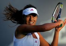 Ana Ivanovic forehand follow through at Standford 2010.JPG