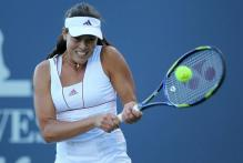 Ana Ivanovic 2 handed backhand at contact in Stanford 2010.JPG