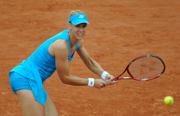 Elena Dementieva hits a 2 handed backhand at the French ...