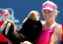 Victoria Azarenka poses with a teddy bear.JPG