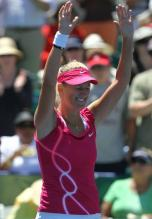 Victoria Azarenka raises her hands in celebration after winning the Stanford championship 2010.JPG