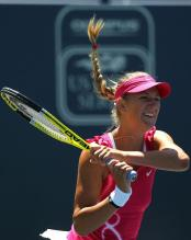 Victoria Azarenka 2 handed backhand follow through at Stanford 2010.JPG