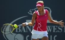 Victoria Azarenka hits a forehand at the Stanford finals 2010.JPG
