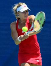 Maria Kirilenko hits a chest-high 2 handed backhand.JPG