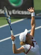 Kim Clijsters ball toss and serve preparation.JPG