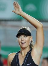 Maria Sharapova raises her arm in celebration.jpg