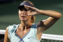 Maria Sharapova gives a salute after winning a match at Cincinnati 2010.JPG