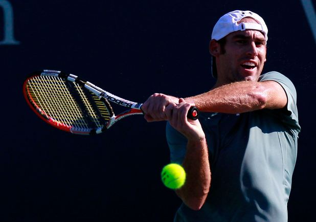 Robby Ginepri 2 handed backhand follow through.JPG