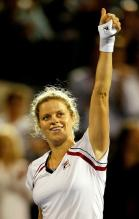 Kim Clijsters asks who wants her wristband after she wins a match at Rogers Cup 2010.JPG