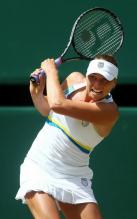 Vera Zvonareva two handed backhand follow through at Wimbledon 2010.JPG