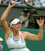 Vera Zvonareva follows through on a topspin lob during Wimbledon 2010.JPG