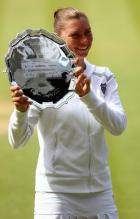 Vera Zvonareva smiles and shows her 2010 Wimbledon trophy.JPG