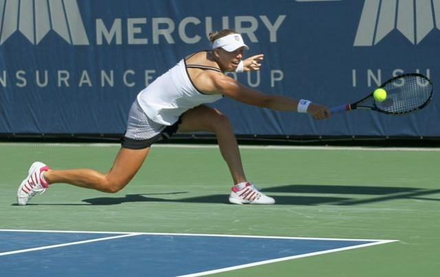 Vera Zvonareva stretches to hit a block backhand shot.JPG