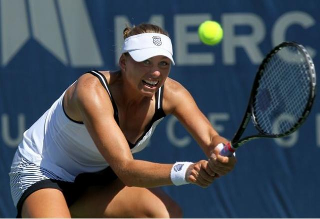 Vera Zvonareva gets down to hit a defensive two handed backhand.JPG