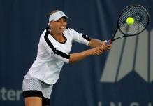 Vera Zvonareva hits a high 2 handed backhand.JPG