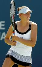 Vera Zvonareva 2 handed backhand follow through in Montreal 2010.JPG