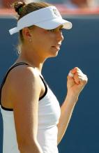 Vera Zvonareva left fist celebration in white tennis dress and visor.JPG