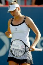 Vera Zvonareva celebrates a point in a white K-Swiss tennis dress.JPG