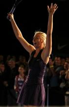 Maria Sharapova laughes and raises her arms during the The Nike Primetime Knockout Tennis Event at Pier 54.JPG