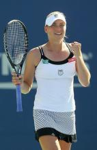 Vera Zvonareva in a K-Swiss tennis tank top smiles after a win at the 2010 US Open.JPG
