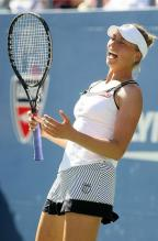 Vera Zvonareva reacts in a white K-Swiss tennis tanktop.JPG