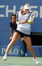 Vera Zvonareva hits a backhand behind the baseline.JPG