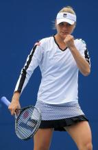 Vera Zvonareva in a white K-Swiss tennis sweatshirt and skirt celebrates a point.JPG