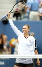 Vera Zvonareva raises her racket in celebration after defeating Carolyn Wozniacki.JPG