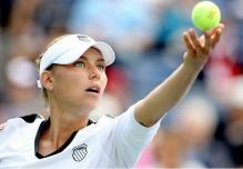 Vera Zvonareva stares at the ball as she tosses it.JPG