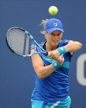 Kim Clijsters 2 handed backhand followthrough at the 2010 US Open.JPG