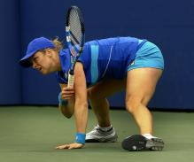 Kim Clijsters looks on after she does the splits.JPG