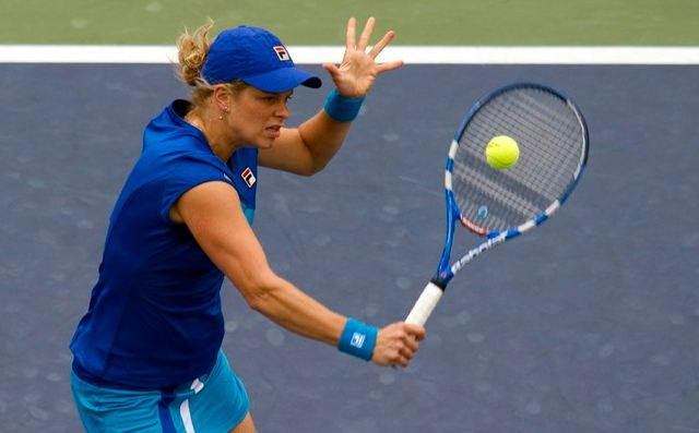 Kim Clijsters hits a backhand volley during the 2010 US ...
