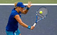 Kim Clijsters hits a backhand volley during the 2010 US Open.JPG