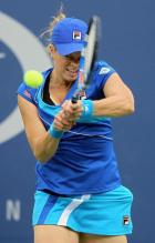 Kim Clijsters 2 handed backhand a in blue tennis outfit and cap.JPG