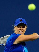 Kim Clijsters forehnad over the shoulder follow through.JPG
