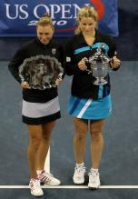 Vera Zvonareva poses with her runner up US Open trophy next to Kim Clijsters.JPG
