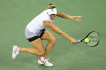 Vera Zvonareva tries to block back a shot with her backhand during the 2010 US Open final.JPG
