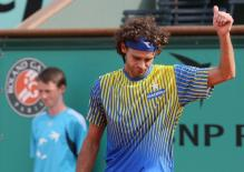 Guga Kuerten acknowledges the crowd during his final French Open match.jpg