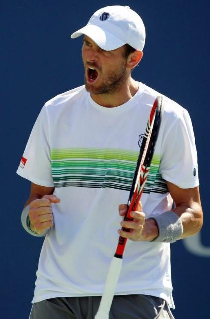 Mardy Fish in a K-Swiss tennis hat and shirt celebrates a point during the US Open 2010.JPG