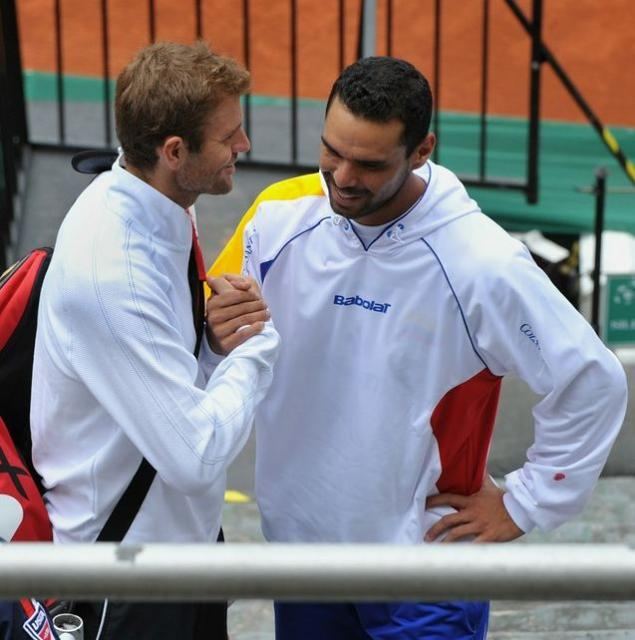Mardy Fish shakes hands with Alejandro Falla.JPG