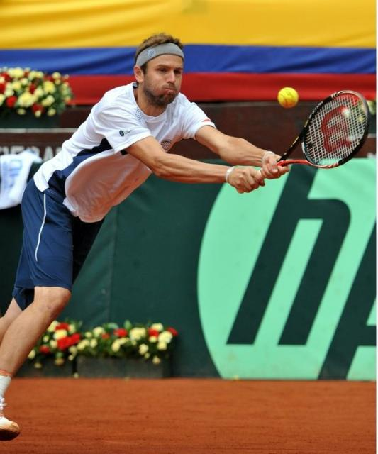 Mardy Fish 2 handed backhand defense on red clay.JPG