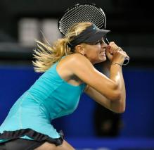 Maria Sharapova 2 handed backhand return of serve in Tokyo 2010.JPG