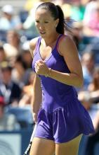 Jelena Jankovic celebrates a point in a purple tennis outfit at the 2010 US Open.JPG