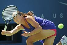 Jelena Jankovic hits a running defensive forehand at the 2010 US Open.JPG