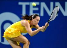 Jelena Jankovic running 2 handed backhand defensive shot in Tokyo.JPG